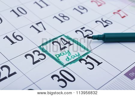 Payday concept. Calendar with green felt pen background. Date in frame, close up