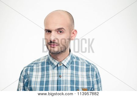 Portrait of handsome young male in plaid shirt with raised eyebrow isolated over white background