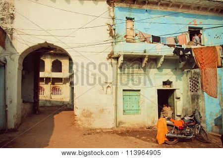 Motobike Stands In Old Courtyard Of The Ancient Indian House