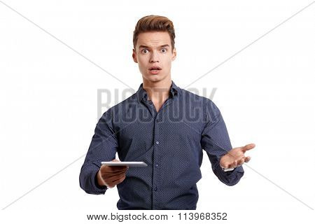 frustrated young man with tablet