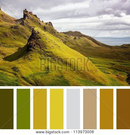 Scenic view of Quiraing mountains with dramatic sky in the Isle of Skye, Scottish highlands, United Kingdom In a colour palette with complimentary colour swatches.