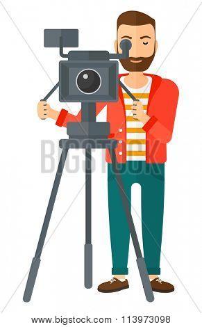 Cameraman with movie camera.