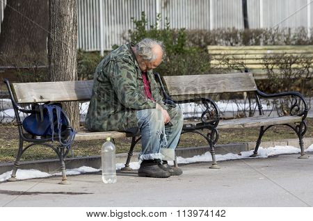 Homeless Man Sleeping On A Bench