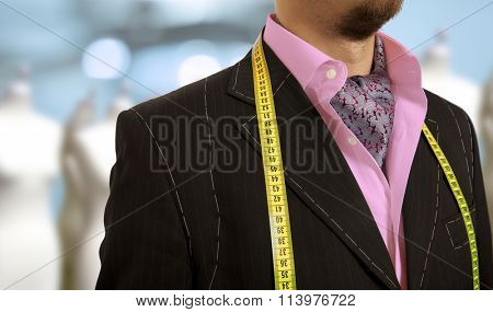 Luxury tailor concept.  Businessman getting measured by a tailor