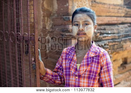 Bagan,Myanmar-December 13,2015 : An unidentified Myanmar girl show her face with Tanaka print in Bagan,Myanmar. Tanaka is very famous cosmetic of local Myanmar people.