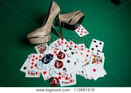 Poker Cards And Woman High Heel On The Table