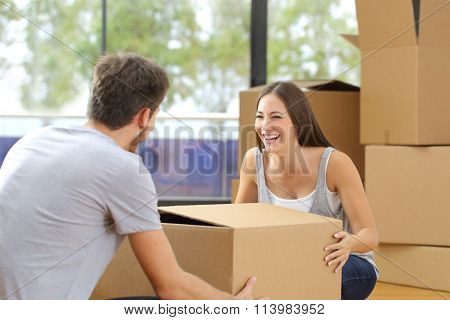 Couple Lifting Box Moving Home