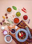 Assortment of Thai food Cooking ingredients and Paste of thai popular food red curry and green curry. poster