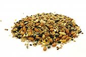 Heap of mixed bird feed on a white background poster