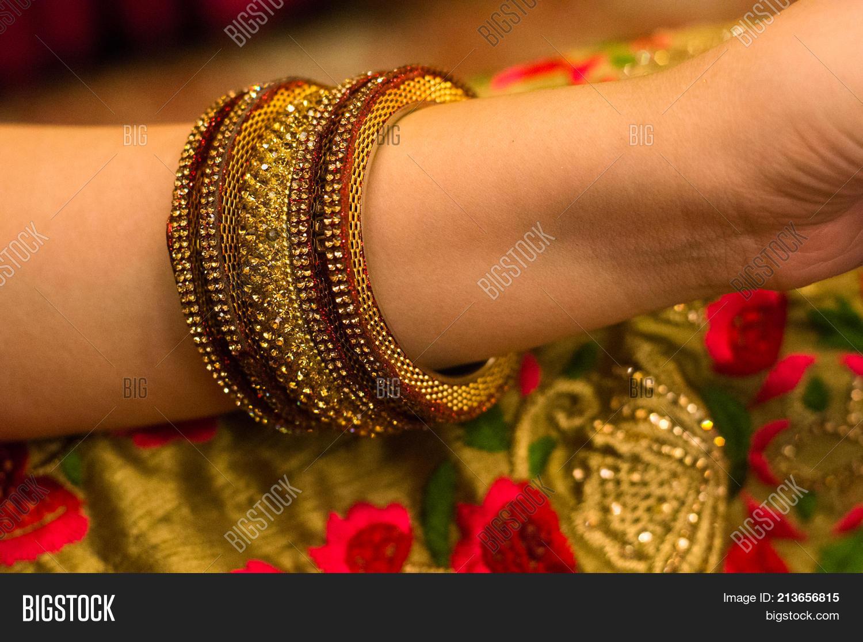 Beautiful Gold Red Bangles On Arm Image & Photo   Bigstock