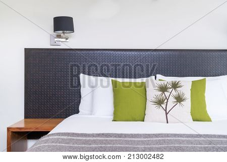 Close Up Bed Headboard Design In Bedroom Interior