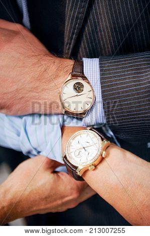 Mens and ladies wrist watches in luxury shop
