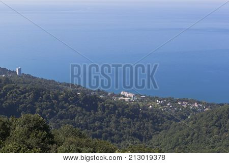 View Bay Quiet and Hosta district of city Sochi with mountains Big Ahun, Krasnodar region, Russia