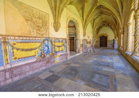 Coimbra, Portugal. Manueline colonnade in Santa Cruz Monastery and Church. Popular landmark and touristic attraction in historic medieval district in Coimbra.