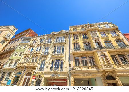 Coimbra, Portugal - August 14, 2017: architecture of ancient palaces in Rua Ferreira Borges in historic center of Lower Coimbra, the medieval part of Portuguese city. Bottom view. Sunny day
