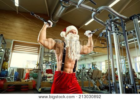 Sports Santa Claus in the gym on Christmas and New Year.