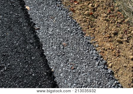 Background Of Layers Of A New Roadway With Asphalt, Gravel, And Dirt, Horizontal Aspect