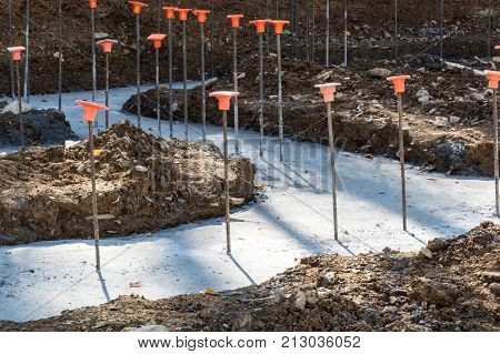 Construction site with rebar in poured footings for a building horizontal aspect poster