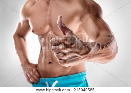 Man Bodybuilder Showing Thumbs Up Gesture