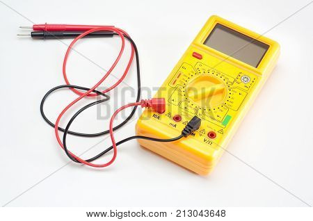 Digital yellow clamp meter with red and black cables, isolated