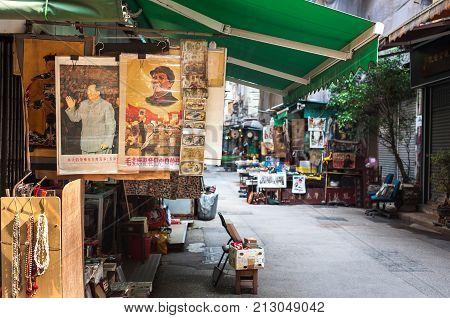 SHEUNG WAN, HONG KONG - OCT 2, 2013 - Vintage Chairman Mao portraits at Upper Lascar Row antiques market, Hong Kong. Cat Street Market is a famous antiques market in the Sheung Wan District of Hong Kong Island.