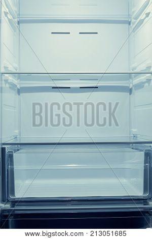 Empty shelves of a modern home refrigerator at close range