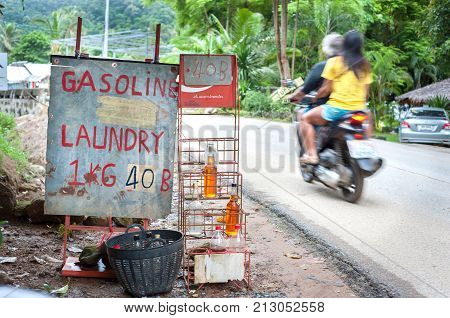 KOH CHANG, THAILAND - JUNE 17, 2015 - Gasoline for sale at a roadside stall on Koh Chang, Thailand.