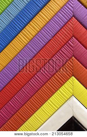 Photo of multicolour bright wooden photo frames