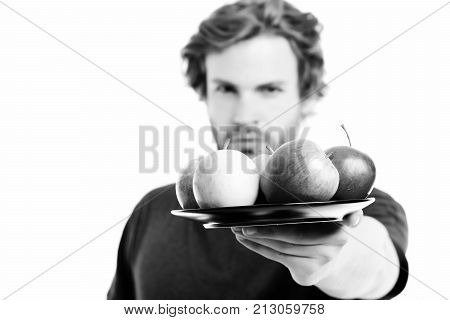 Face Expression Of Strong And Confident Man Offering Apples
