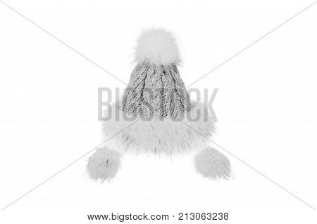 Knitted winter hat with fur isolated on white background.