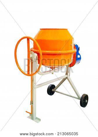 Small orange concrete mixer machine and wheelbarrow isolate on white background