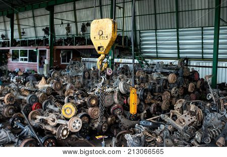 The Recycle Garage Sell About Old Car Wheel Axles And Used Parts Of Car.