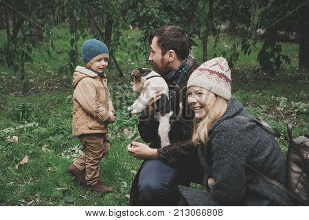 Parents give the child a dog fox terrier. Outdoor