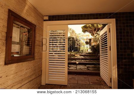 Stunning entrance mansion an garden with building on the background poster