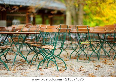 Empty Outdoor Cafe On Beautiful Autumn Day In Munich, Germany.