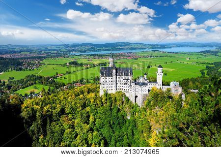 Famous Neuschwanstein Castle, Fairy-tale Palace On A Rugged Hill Above The Village Of Hohenschwangau