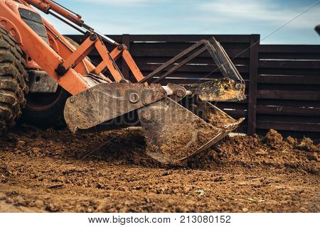 Wheel Loader Excavator, Backhoe Loader Machinery Details Working Around The Construction Site