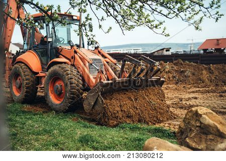 Heavy Duty Earth Moving Bulldozer Doing Landscaping Works And Moving Soil