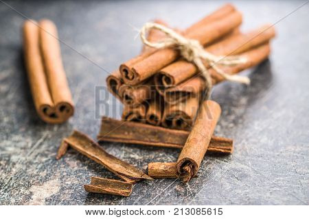 Cinnamon sticks spice on old table.