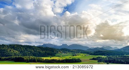 Breathtaking Lansdcape Of Mountains, Forests And Small Bavarian Villages In The Distance. Scenic Vie
