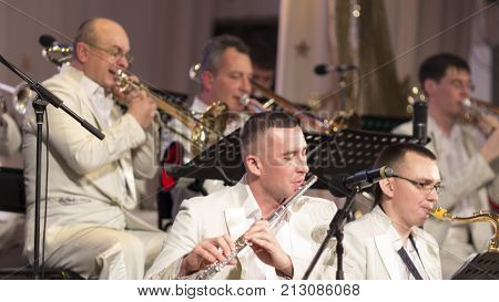 Kostanay Kazakhstan 11-10-2017 Kostanay jazz collective in white suits performs at the opening of the jazz festival on the stage of the regional philharmonic society.