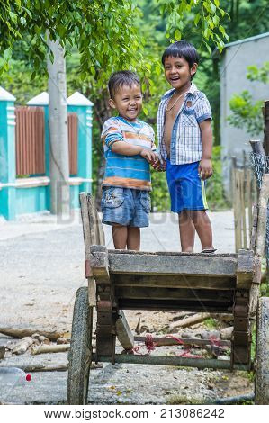 QUANG NAM VIETNAM - OCT 07 : Children from the Cotu Minority in Quang Nam Vietnam on October 07 2017. The Cotu minority mostly live in central Vietnam and eastern Laos