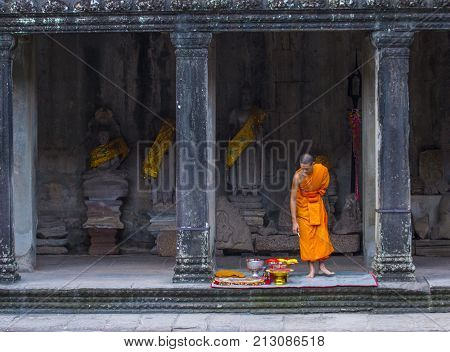 SIEM REAP CAMBODIA - OCT 17 : Budhist monk at the Angkor Wat Temple in Siem Reap Cambodia on October 17 2017 The Angkor Wat is an UNESCO World Herutage site since 1992