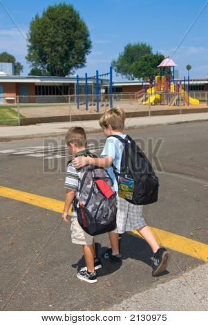 two brothers cross the street at a cross walk on their way to school poster