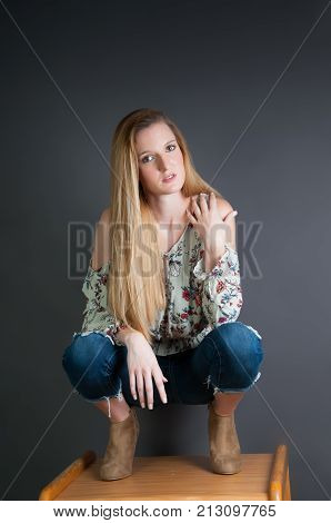 Pretty Blond Girl Against A Grey Background