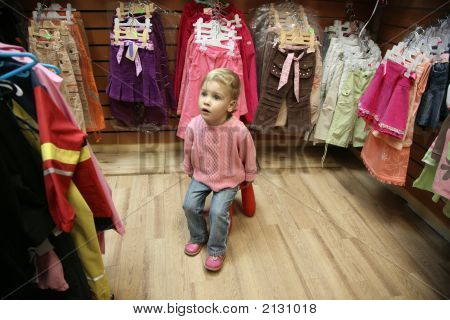 Child In Dress Shop