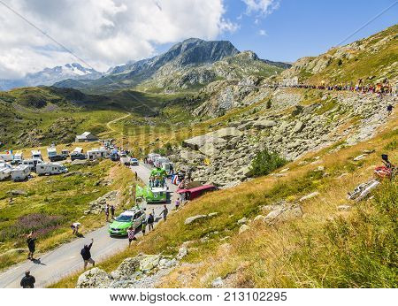 Col de la Croix de Fer France - 25 July 2015: Skoda caravan driving on the road to the Col de la Croix de Fer in Alps during the stage 20 of Le Tour de France 2015. Skoda provides the official car of the competition and sponsor the Green Jersey.
