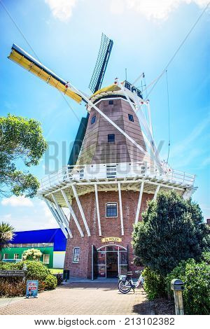 Foxton New Zealand - 28 November 2015: The De Molen Windmill. A Foxton landmark the full size replica of a Dutch windmill called De Molen is a working windmill which makes stone-ground flour which can be purchased inside the mill`s souvenir shop.