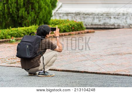 Photographer Shoots On The Territory Of A Buddhist Temple In Louangphabang, Laos. Copy Space For Tex