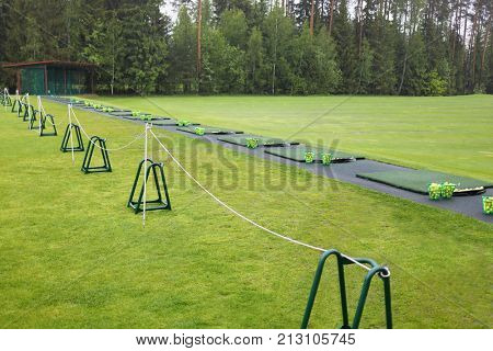 Starting area with baskets and balls on the golf course in rainy weather